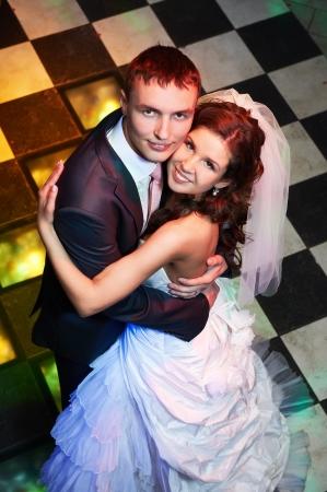 Happy bride and groom in wedding day in dance floor