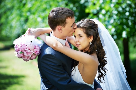 Beauty bride and groom on wedding walk in park Stock Photo