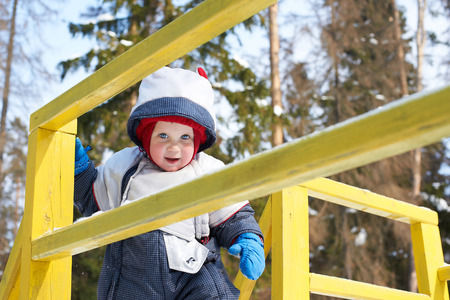 beanies: Little boy in winter suit on baby hill