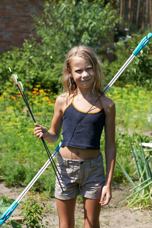 pointed arrows: Girl with  bow and arrows outdoors