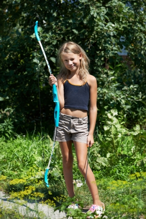pointed arrows: Girl with bow on background of nature