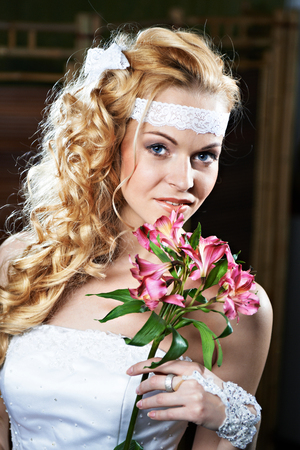 Portrait beautiful bride with bouquet of lily photo