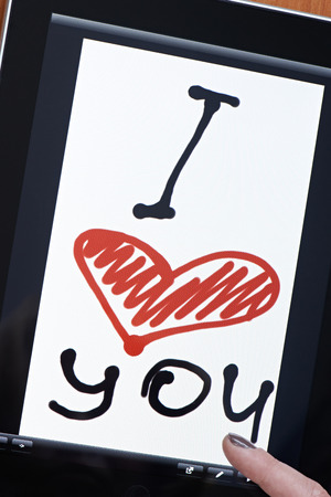 Tablet with inscription I love you