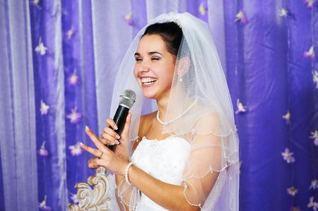 Joyful bride speaks at banquet on her wedding Banco de Imagens