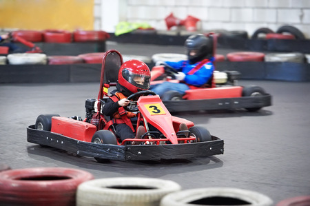 Competition for children karting indoors 스톡 콘텐츠
