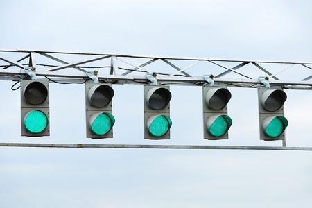Racing green traffic light on background sky photo
