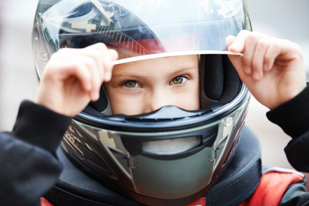 Portrait of a young racer in helmet closeup Stock Photo - 26822510