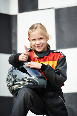 Happy little girl on karting competition photo