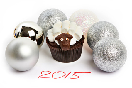 Cupcake lamb with silver Christmas balls as simbol 2015 new years isolated on white background photo