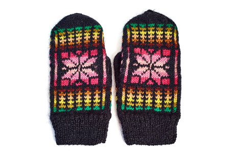 Knitted mittens on white background photo