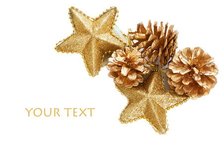 Gold plated pine cones and stars macro isolated on white photo