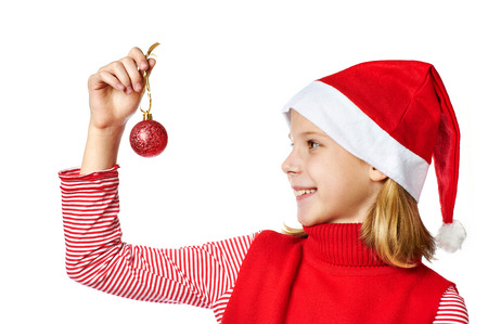 blithe: Beautiful girl in red Santa hat with christmas ball