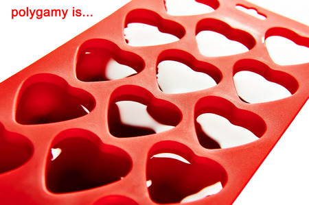polygamy: Red container for ice form of hearts isolated Stock Photo
