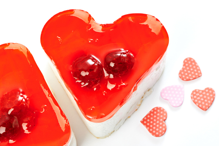 Two jelly heart-shaped cakes isolated in white background photo