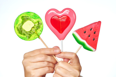 Lollipop in the form of heart, watermelon and kiwi photo