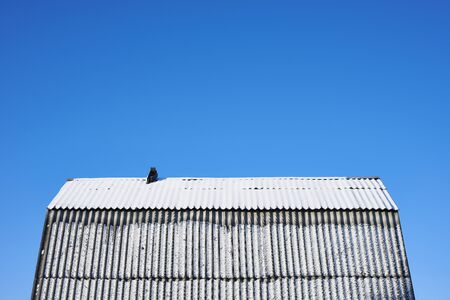 Roof of a village house in the snow a clear winter day photo