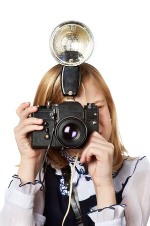 Girl reporter photographer with retro camera and flash isolated photo