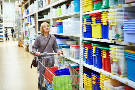 Women shopping in supermarket with cart Banco de Imagens