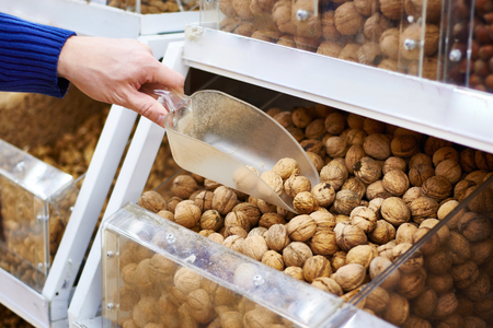 caloric: Walnuts on store shelves and hand the buyer with a shovel
