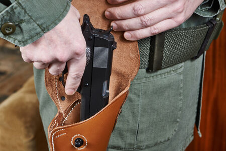 holster: Soldier takes out a gun out of the holster