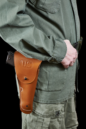 holster: Soldier in uniform and on a belt holster with a gun