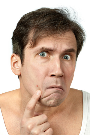 impure: Men squeezing a pimple on white background