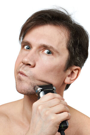 electric razor: Man shaving face with electric razor on white background