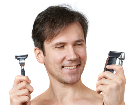 aftershave: Man chooses between two razors Stock Photo
