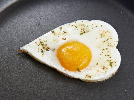 fried eggs: Fried eggs in heart form for breakfast