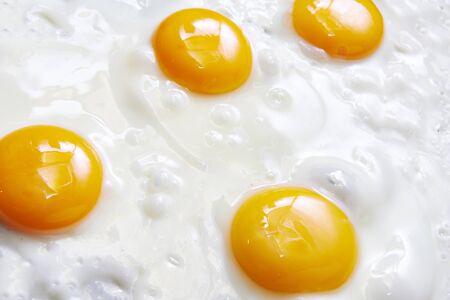 fried eggs: Fried eggs close up macro Stock Photo