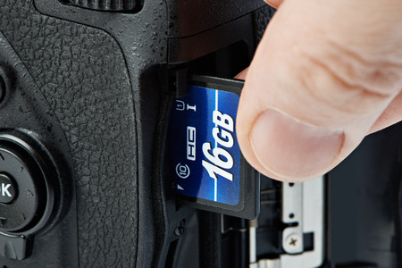 Flash card SD and DSLR camera close-up photo