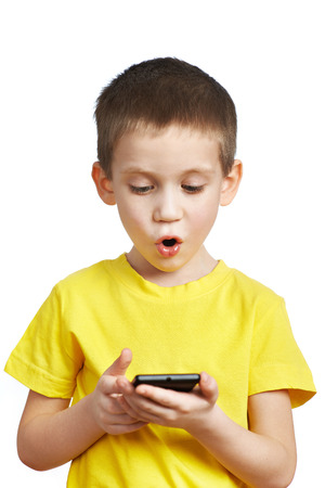 Surprised boy looking at phone isolated photo