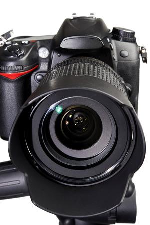 dslr: DSLR black camera on white isolated