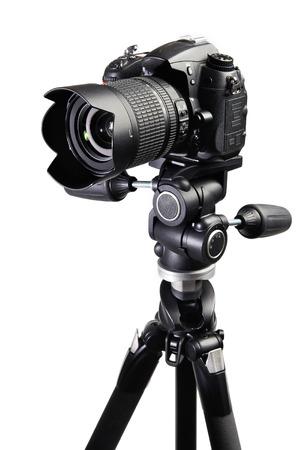 DSLR black camera on tripod on white isolated