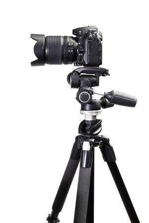 dslr: DSLR black camera on tripod on white isolated
