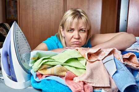 tortured: Tired woman at the ironing board