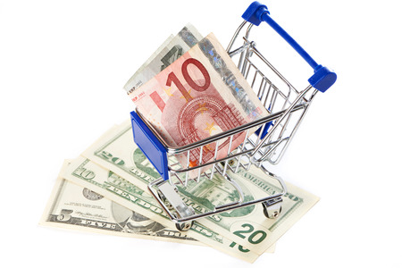 shopping trolley: Shopping trolley with money isolated on white background