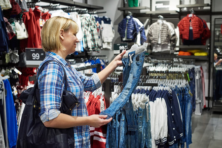 clothing store: Mother woman shopping clothes for childrens