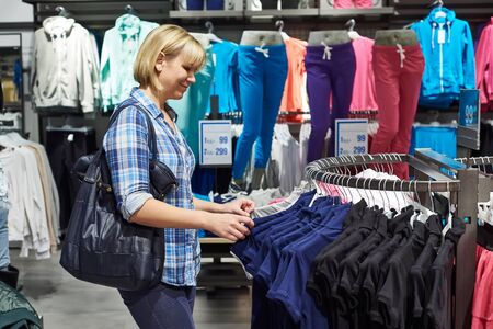clothing store: Beautiful blonde woman shopping in clothing store