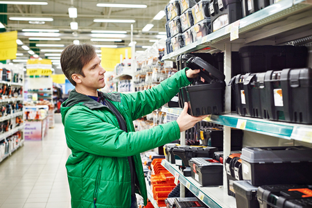 Man buying toolbox in supermarket photo