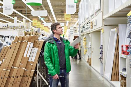 bathroom equipment: Man shopping for bathroom equipment in DIY shop Stock Photo