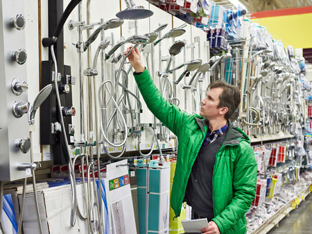 Man shopping for bathroom equipment in DIY shop photo
