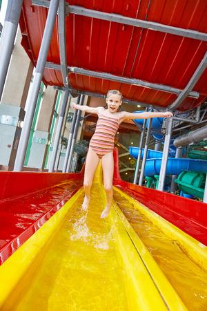 aqua park: Happy little girl jumping in aquapark