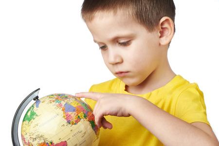 Little boy with globe isolated on white background Stock Photo