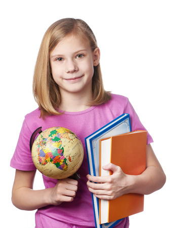 textbooks: Girl with globe and textbooks isolated on white background