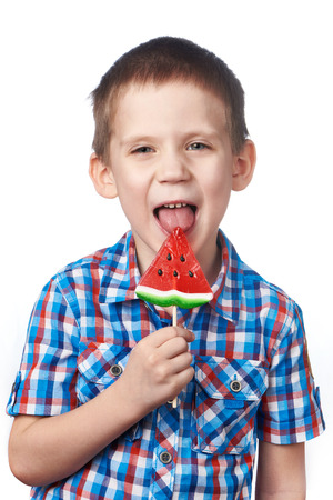 Little boy eating a lollipop watermelon isolated photo