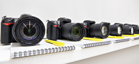 Reflex digital cameras with notepad in the classroom photoschool Stock Photo