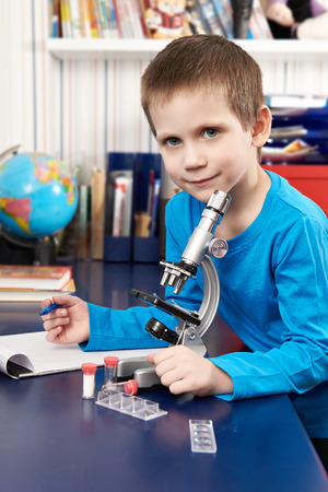 solidified: Happy boy with microscope at home
