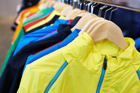 yellow jacket: Sportswear on a hanger in the store Stock Photo