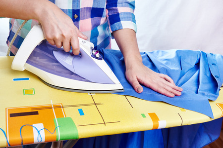 ironed: Woman ironed mens shirt close-up Stock Photo